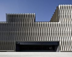 Biomedical Research Center - Pamplona, Spain;  designed by Vaillo + Irrigaray;  uses louvers constructed of perforated aluminum panels arranged in a tessellated origami pattern;  photo by Pegenaute Studio: