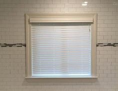 Faux Wood Blinds are the best choice for bathrooms and shower areas.  They have that classic look but will not erode over time from steam and extreme moisture.  We have a very large selection - find out more today.