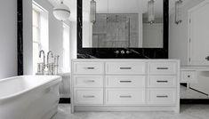 Modern black and white bathroom features a white glass globe pendant, Ralph Lauren Hendricks Large . Bathroom Vanity Drawers, White Vanity Bathroom, Modern Bathroom, Small Bathrooms, Black Marble Bathroom, Floor To Ceiling Windows, Bathroom Hardware, Bathroom Renos, Backsplash