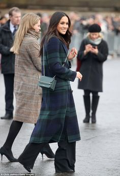 The Meghan effect in full swing: Ms Markle opted for a bottle green Strathberry East/ West...