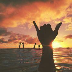 sunset surf shakas