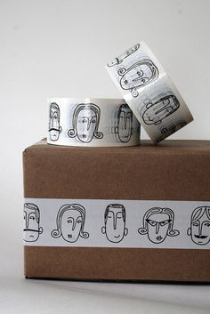 Packaging.  idea: Rubber stamp kitty faces onto white tape or paper.