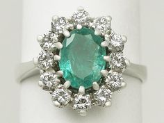 We love cluster rings here at AC Silver and this stunning 1.50 carat natural emerald and 1.12 carat diamond, 14 carat white gold one is no exception! The diamonds are beautifully matched and the Oval Mixed cut emerald is simply gorgeous! SKU: A1202 Price: GBP £2250.00 http://www.acsilver.co.uk/shop/pc/1-50-ct-Emerald-and-1-12-ct-Diamond-14-ct-White-Gold-Cluster-Ring-Vintage-Circa-1970-168p6808.htm#.VKvAbS6_AR0 #emerald #diamond #wedding #engagement #ring #jewellery #vintage #cluster