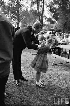 Steve McQueen signing an autograph (John Dominis. 1963)