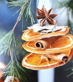 Easy & pretty Christmas decorations. Dried orange slices, threaded with cinnamon and star anise. Gorgeous