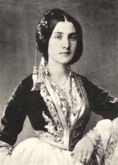 """Greek woman from Smyrna, an important Aegean coastal town, today in Turkey. Many locales were named after Smyrna, notably in the USA. There's a """"Smyrna"""" in the states of California, Delaware, Georgia, Maine, Michigan, North-Carolina & South-Carolina, Tennessee ... and two of them in New York. The original town itself cannot be called """"Smyrna"""" however. The Turks insist that """"Izmir"""", the  Turkish mispronunciation of its name, must instead be used in all languages."""