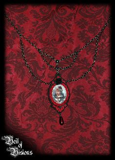 Beautiful black chain necklace with embroidery in red embracing the Vlad the Impaler portrait! Decorated with a blood red drop pendant and a black rose. Unique / One-of-a-Kind! £26