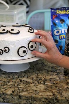 Oreo cookie eyeballs on a cake ~ how cute!