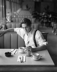 Hugh Grant, suspended in tea time.