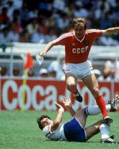 France 1 USSR 1 in 1986 in Leon. Ivan Yaremchuk jumps over his marker in Group C at the World Cup Finals.