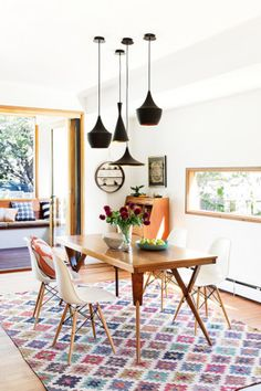 Tour a Chic, Eco-Savvy Family Home in Australia Bright dining space with a cluster of black pendant lights, a printed area rug, and modern chairs Interior Exterior, Home Interior, Interior Decorating, Interior Design, Decorating Ideas, Furniture Layout, Dining Room Furniture, Pool Furniture, Dining Rooms