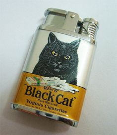 Dexter lighter with a vintage ad for Black Cat cigerettes