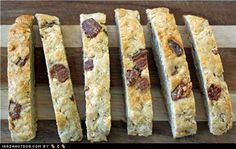 Bacon Biscotti!  Ingredients:    6 slices bacon, chopped  canola or olive oil (optional)  1 1/2 cups (375 mL) flour  1 1/2 cups (375 mL) whole wheat flour  1 cup (250 mL) oats  1 tsp. (5 mL) baking powder  1/2 cup (125 mL) water  2 large eggs  1/4 cup (60 mL) bacon drippings or canola oil  2 Tbsp. (30 mL) honey    Directions:    1. Preheat oven to 350°F.    2. In a skillet set over medium-high heat, cook the bacon until crisp; remove with a slotted spoon and set aside, reserving the…