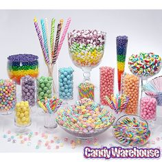 Love a candy Buffet Display so easy jars, a vase, and beautiful glass bowls and your done. Or even placed on your dessert buffet.