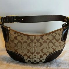 """Coach mini purse Bought this from a fellow Posher and it's beautiful and in excellent condition just a little smaller than I anticipated. Classic brown with Coach """"C"""" fabric and leather trim. Super clean and no markings or scratches. Can be worn on the shoulder as strap is adjustable. Dimensions are 11 in width and 7 in high. Coach Bags Mini Bags"""