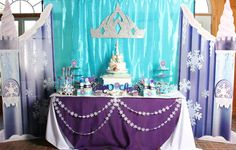 Frozen girl birthday party dessert table and backdrop!  See more party planning ideas at CatchMyParty.com!