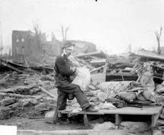 A man searches amid the destruction of homes in the northeast section of De Soto. The ruined school can be seen in the background.  I grew up in a house right where this man is standing.