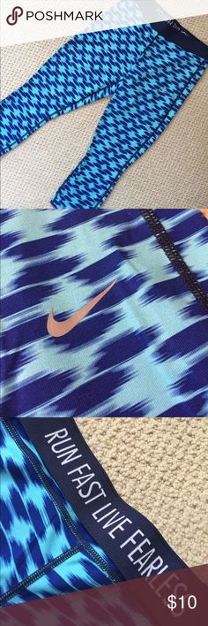 Nike Blue running crop These are great workout capris! They hit at mid calf when worn. They're lightweight and don't trap in heat. The waistband can be rolled down flat or worn up for more coverage. There is a small zip pocket on the rear hip. They are missing the drawstring (see photo). Nike Pants Ankle & Cropped