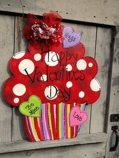 This fun decorative valentines door hanger is the perfect accent for any room or door to celebrate St. Valentines day The designs are a combo of polka dots, and my signature swirls. Colors are a combo of pinks , lavenders and mint greens which is painted with high quality