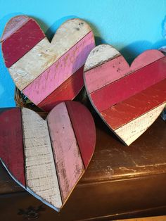 This Wooden Pallet Heart is made from recycled pallets that have been painted, sanded, stained, and varnished, with a solid sheet of plywood as