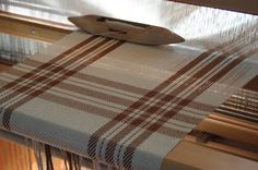 "When we discovered ""on the loom"" photos of the beautiful table runners, kitchen towels and more on @Kate Kilgus' Etsy shop we were SUPER EXCITED.  This is one of those photos... Nutfield Weaver's Handwoven farmhouse plaid table runner in adobe brown and ivory ON THE LOOM!  Doesn't this inspire you to learn a time-honored tradition like weaving? Or perhaps, spinning, sewing, quilting, etc?"