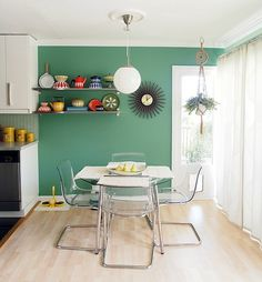 A Standard White Apartment Gets a Cool Colorful Makeover. Love the transparent chair mixed with that mint green wall