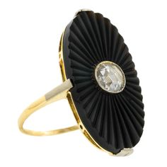 Art Deco Onyx & Rose Cut Diamond Ring, 0.33ct:: centering a bezel set Rose cut diamond measuring app. 5.0mm and weighing app. 0.33ct., in a carved, fluted oval onyx measuring app. 25.0 x 13.0mm, fashioned in 14k. Circa 1935. Size 6.5   103529R USD 2900
