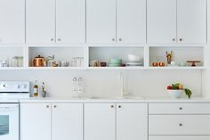 Extremely simple IKEA kitchen - I like the cabinets without doors used as open shelving.