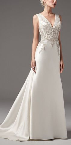 Sottero and Midgley - CLAYTON, This chic and sexy Yaron Mikado sheath wedding dress features exquisite bead and Swarovski crystal embellishments along the bodice. #weddinggowns