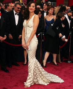 Marion looks lovely in this fish scale dress from John Paul Gaultier. His designs are amazing.
