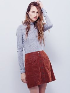 Come A Little Closer Mini   Faux suede mini skirt featuring a button-up front with snap closures and front slip pockets.  In a flattering A-line silhouette.  Lined.