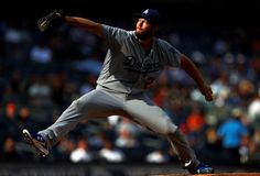 Light and shadow:     The Dodgers' Clayton Kershaw delivers a pitch the Yankees in New York on Wednesday. The Dodgers won 2-0.