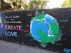 """""""Atuned to the majesty of Music the marched as one with Earth"""".  This new mural is located near College Nine dormitories.  #music #unifying #love #earth #art #UCSC #mural"""