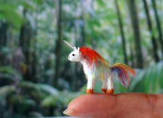 Handmade miniature crochet unicorn. Made from egyptian cotton threads.    Suitable for a miniature animal collection or a dollhouse.    Height 25mm (1