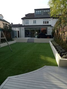 modern minimalist garden design low maintenance high impact garden design raised white wall beds grey decking east grass lawn turf sunken garden with fire and chimney flat trees balham wandsworth london 4 Modern Landscape Design, Modern Garden Design, Modern Landscaping, Landscaping Ideas, Garden Landscaping, Modern Patio, Modern Design, Backyard Plants, House Landscape