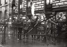 One of the most widely circulated photos of the early days of Hitler and his Nazis is this picture shot during the abortive Beer Hall putsch in Munich in 1923 in the effort to overthrow the Weimar Republic. Here uncropped, the image is dominated by the flag of the putschists held aloft by no other than Heinrich Himmler, a lowly early member of the NSDAP and Hitler admirer.Ten years later, Himmler was well on his way of becoming one of the most notorious mass killers in history.