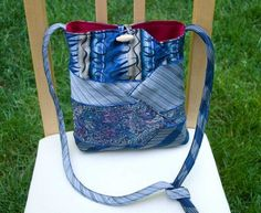 Made from 4 beautiful silk ties in shades of blues, silvers, and lavenders and lined in bright red Necktie Purse, Necktie Quilt, Old Neck Ties, Old Ties, Tie Crafts, Recycling, Denim Bag, Purses And Bags, Jean Purses