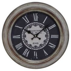 """Distressed metal wall clock with Roman numeral dial.  Product: Wall clockConstruction Material: MetalColor: Weathered beige and blackAccommodates: Batteries - not includedDimensions: 15"""" DiameterNote: Not recommended for outdoor useCleaning and Care: Wipe with a dry cloth"""