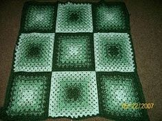 Granny squares put this whole lapghan together. Two strands of yarn are continuously used for the pattern.You'll love the different shades of green the lapghan creates.