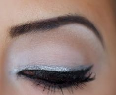Silver Eyeliner on top of black eyeliner look