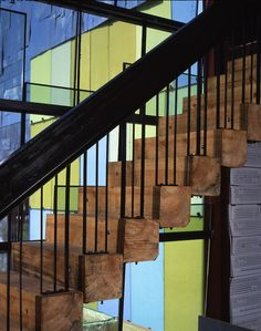 #Industrial wood and iron #stairs in front of #colorful wall panels