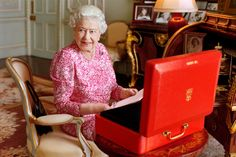 In this handout photo released by Buckingham Palace, Queen Elizabeth II is seated at her desk in her private audience room at Buckingham Palace with one of her official red boxes. Photo / Getty Images