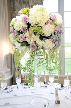 This pale classic centerpiece of white, green and purple was perfect for our bride and groom's elegant wedding at The Ashford Estate.