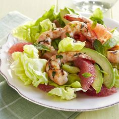 Tangy grapefruit and cool avocado complement the grilled shrimp in this colorful salad. #summerrecipes