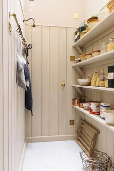 The dreamy walk in pantry in deVOL's St. John's Square showroom, complete with tongue and groove panelling and a brass hanging rail