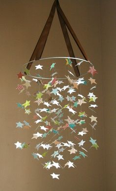Little Guy STAR Mobile: use needle to pierce hole in center of star and thread through fishing line and not at bottom, working up. Sew all the ribbon pieces together for perfect length. Cross section the center hoop for more places to hang stars.