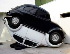 A cool modern Yin Yang Cars Art inspired sculpture made of VW bugs