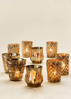 Bronze/copper mercury glass votives - more of an antiqued look instead of shiney.