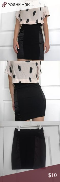Black Pencil Skirt A black pencil skirt with some geometric designs on the sides. Includes a zipper on the back which makes it easy to put on. Worn once, so in great condition. If you like the shirt paired, I'm also selling that.  Tally Weijl Skirts Pencil