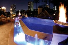 At night this rooftop perimeter-overflow pool becomes a shimmering showpiece, lighting up the city sky just as brightly as the surrounding skyscrapers. Photo courtesy of Neptune Pools, Inc.